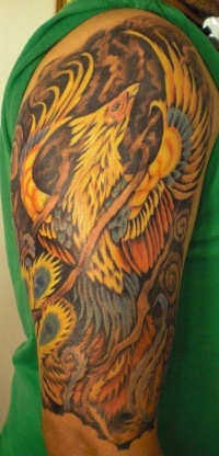 Rising phoenix sleeve tattoo